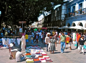 People strolling; vendors selling