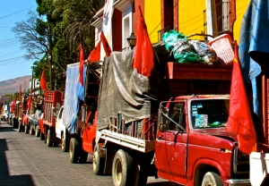 Trash collectors trucks with red flags