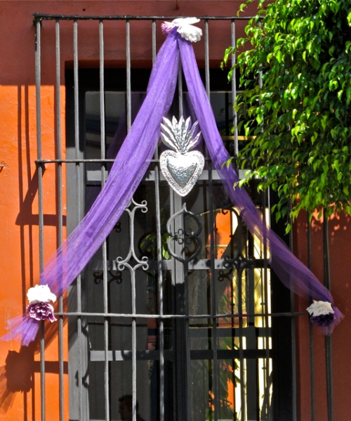 window decoration: purple tule, tin heart, and flowers