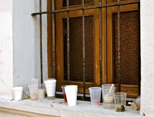 Empty cups on window sill
