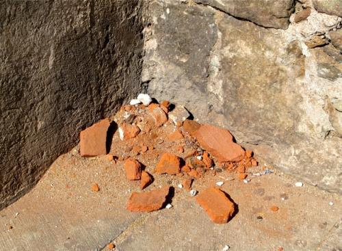Brick debris on sidewalk.