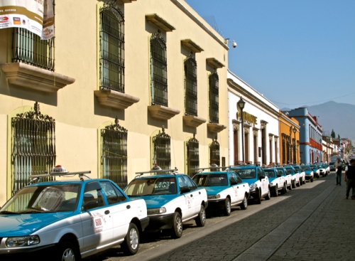 Taxis line up on side street
