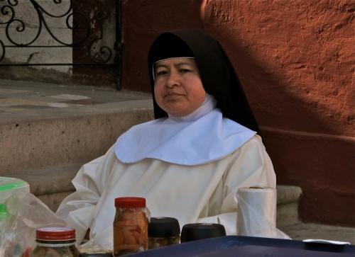 Seated nun