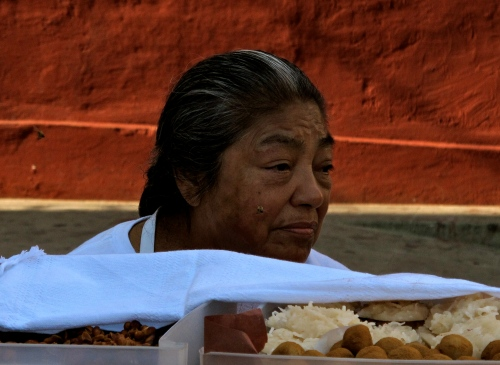 Woman dulce vendor outside Sangre de Cristo