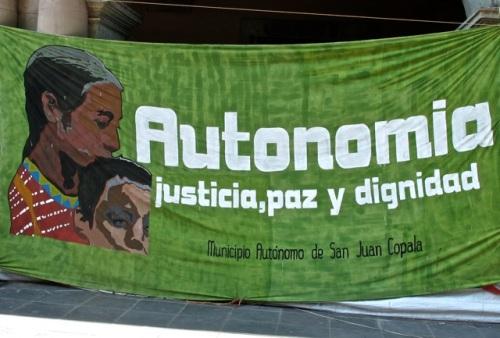 Banner:  Face of mother and son and slogan:  Autonomia, justicia, paz, dignidad; Municipio Autónomo de San juan Copala.