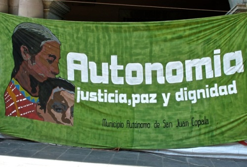 Banner:  Face of mother and son and slogan:  Autonomia, justicia, paz, dignidad; Municipio Autónomo de San juan Copala.