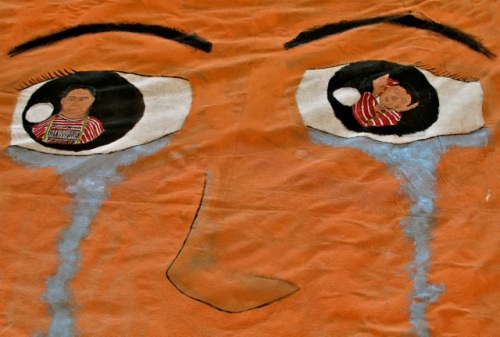 Banner - close-up of eyes, nose, and tears running down cheeks.