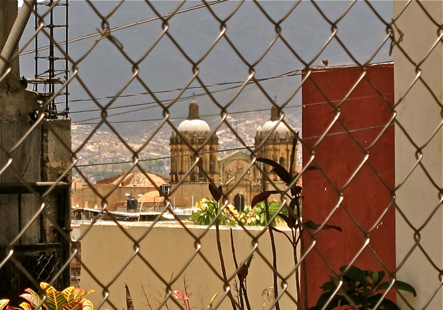Santo Domingo through chain-link fence.