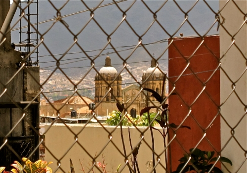 Santo Domingo through chain-link fence.