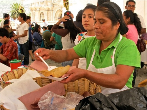 Woman serving tamales