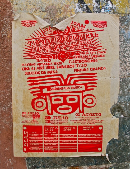 "Poster pasted on side of building advertising ""Tianguis Cultural; Libertad y Resistencia; Plazuela del Carmen Alto; 25 Julio - 01 Agosto"""