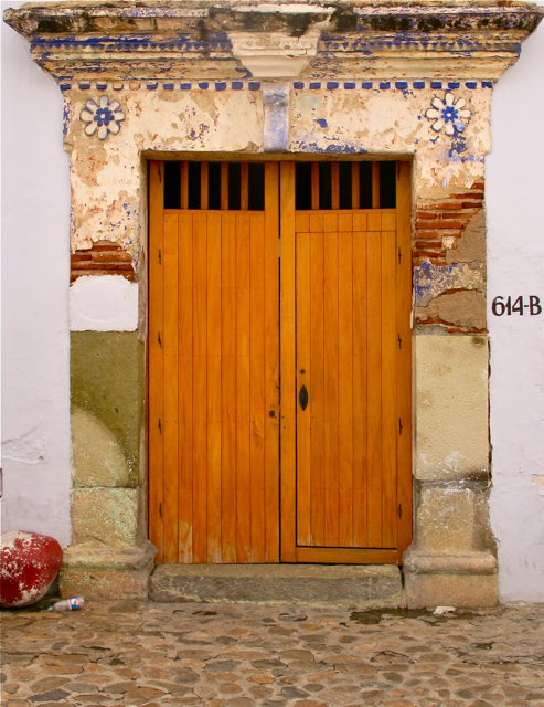 Doorway on a cobblestone street.