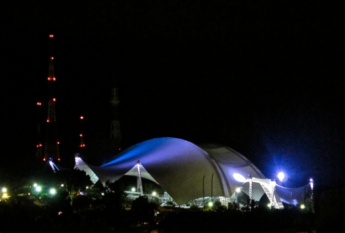 Guelaguetza Auditorium with lights glowing at night