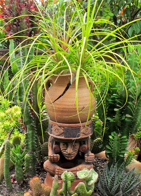 Garden pot breaking on top of the garden god