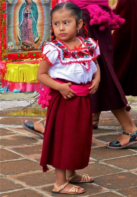 Very young Zapotec girl in traditional dress.