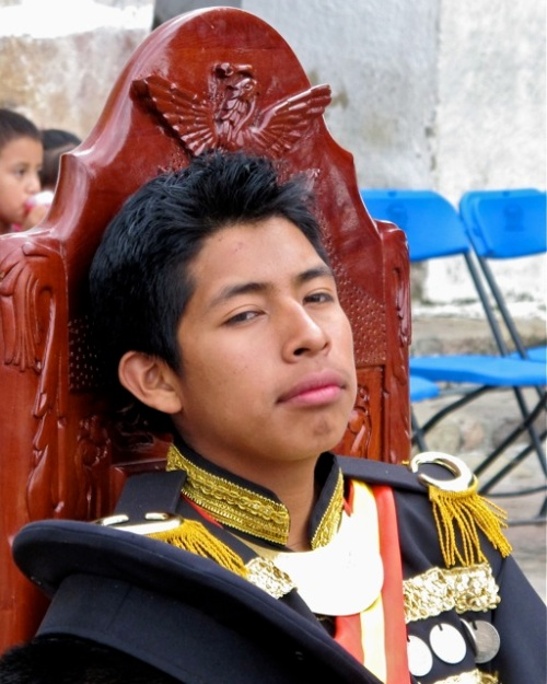 Cortes resting on his throne.