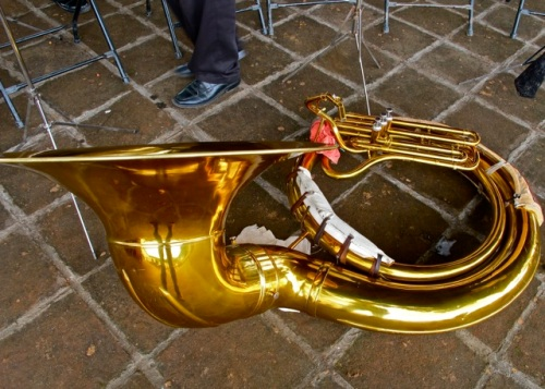 Tuba laying on the ground.