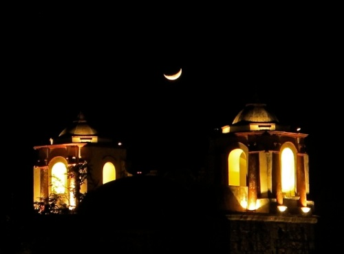 Crescent moon between the bell towers of San Jose church, in Oaxaca