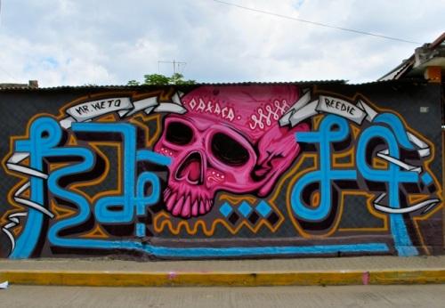 Wall mural: magenta skull with writing: Mr. Weto; Oaxaca; Reedie