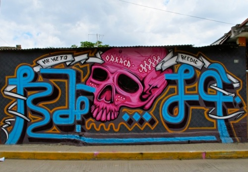 Wall mural: magenta skull with writing: Mr. Weto; Oaxaca; Reedie