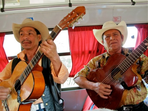 Two guitarists on bus.