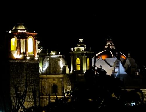 Bell tower of Church of San José and bell tower, facade, and dome of Basílica de la Soledad