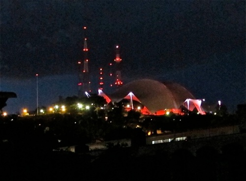 Guelaguetza auditorium glowing with red lights at night