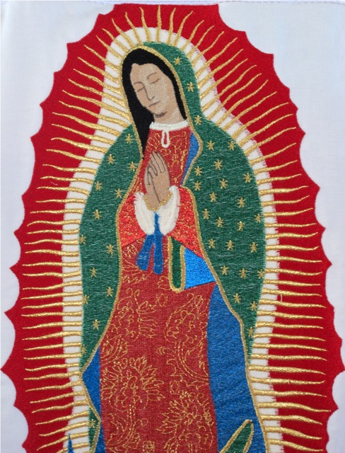 Closeup of the Virgin of Guadalupe on the back of Moctezuma's cape.