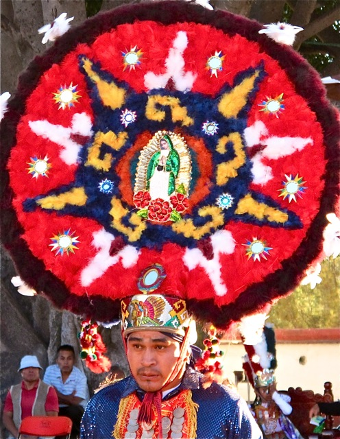 Feathered headdress with image of the Virgin of Guadalupe  in the center.