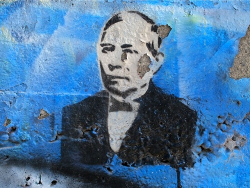 Wall art of Benito Juárez on seawall