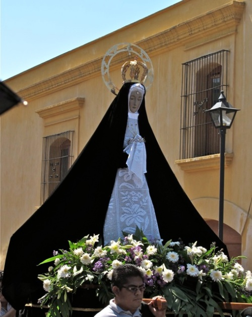 Virgen de La Soledad being carried through the streets with plain purple cape