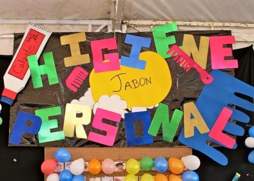 """Banner above a balloon dart board: """"Higiene Personal"""""""