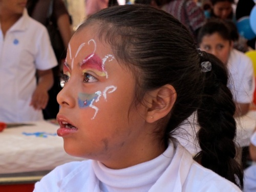 Young girl with face painted
