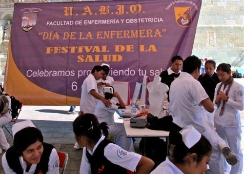 """Banner: U.A.B.J.O.; Facultad de enfermería y obstetricia; """"Día de la enfermera""""; Festival de la Salud; Celebramos..."""