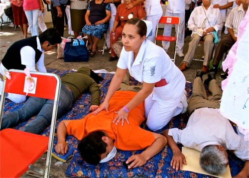 Nurse giving a back massage
