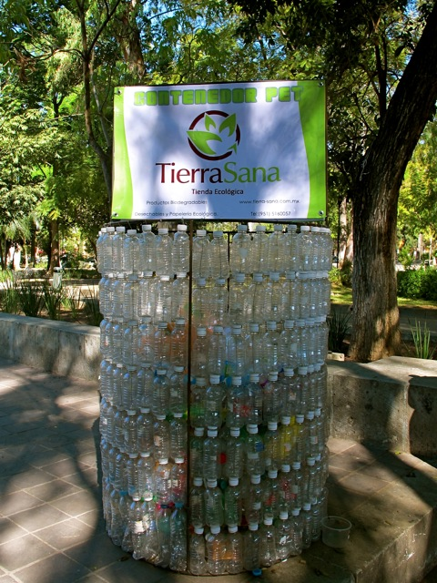 Waste basket made from plastic bottles with a Tierra Sana sign on top