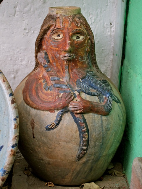 Vase in the shape of a woman's face and rounded body