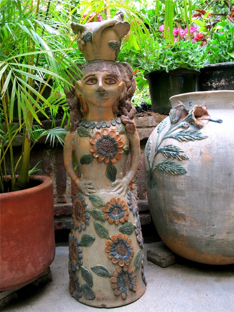 Tall vase in the shape of a woman.