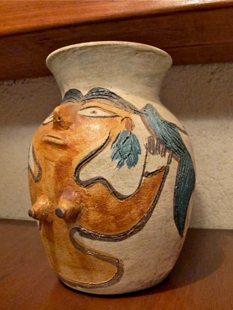 Vase with image of a woman, with pointy breasts.