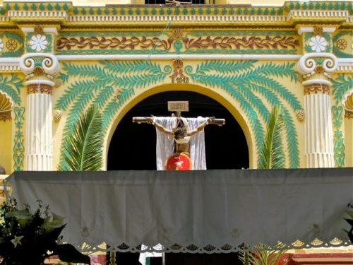 Large crucifix on the stage in front of the church