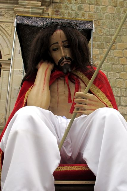 Jesus seated; head leaning on hand; on arm resting on knee