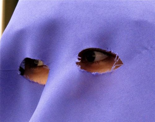 purple hooded face with only eyes showing