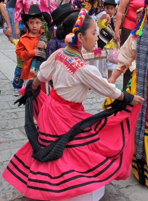 Girl in Mixteca costume dancing.
