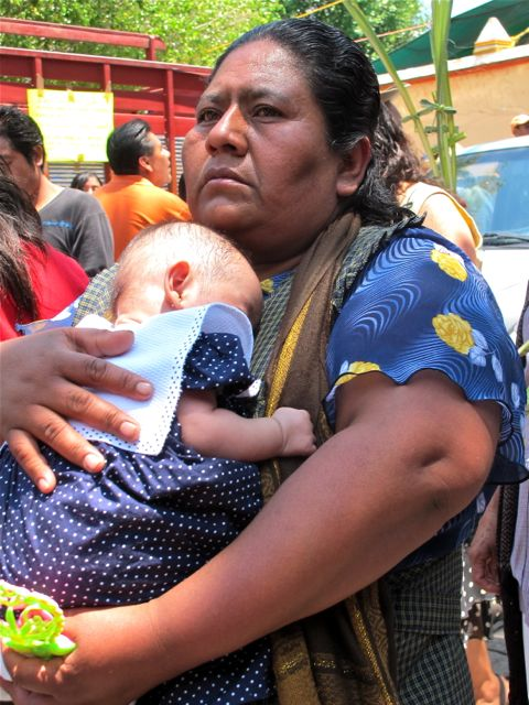 Close up of woman holding a baby