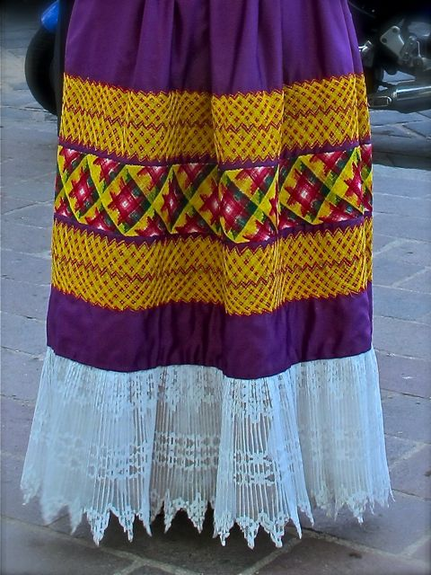Geometric yellow and red embroidery on purple skirt with lace bottom