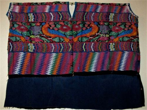 Multicolored huipil with peacock design