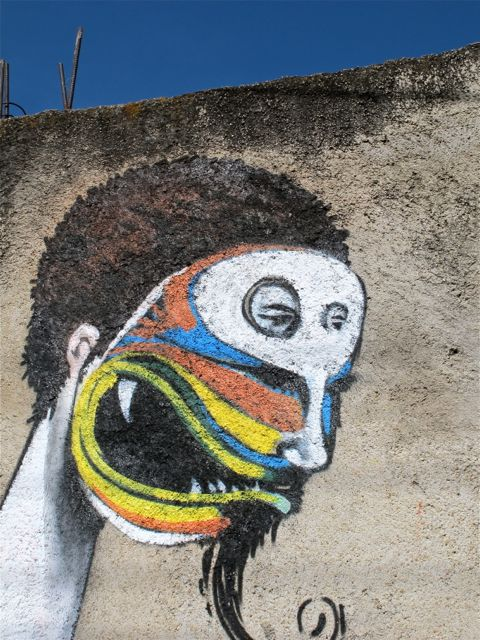 Closeup of colorfully painted face on wall