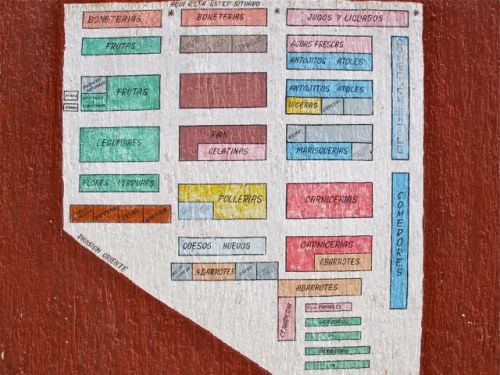 Color coded map of Mercado IV Centenario stalls painted on wall.