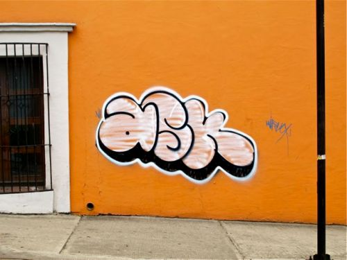 "The word ""ask"" spray painted on wall."