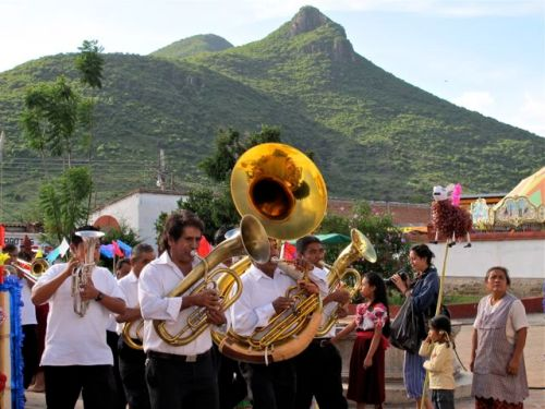 Band with tuba in front; mountain in background